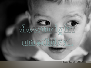 Close up photo of small child's face, the child is directing its eyes sideways, as if suspicious