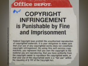 Notice from an Office Depot copier: COPYRIGHT INFRINGEMENT is Punishable by Fine and Imprisonment (and much more very small print)